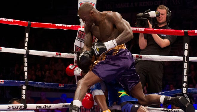 Deontay Wilder, top, beats England's Audley Harrison in the first round during their heavyweight boxing match Saturday.