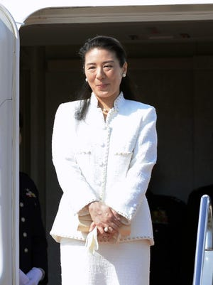 Japan's Crown Princess Masako, who has been under treatment for a stress-induced illness, prepares to leave for the Netherlands, at Haneda Airport in Tokyo on Sunday.