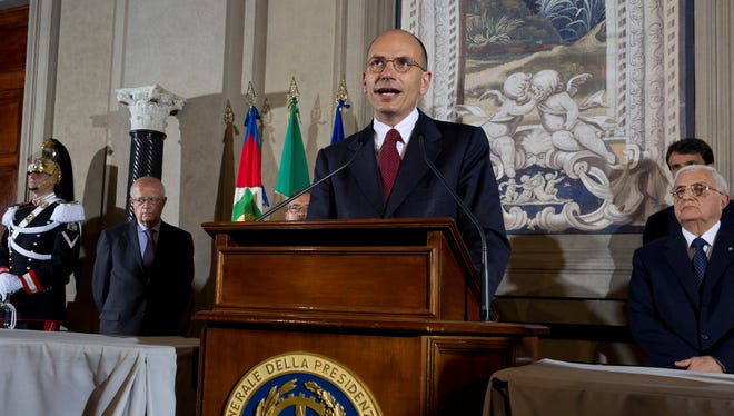 Italian Premier-designate Enrico Letta speaks during a press conference at the Quirinale Presidential Palace on Saturday in Rome.