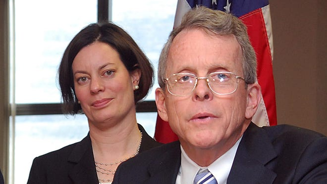 Ohio Attorney General Mike DeWine, right, answers questions about the prosecution of two juveniles in a rape case that gained national attention.