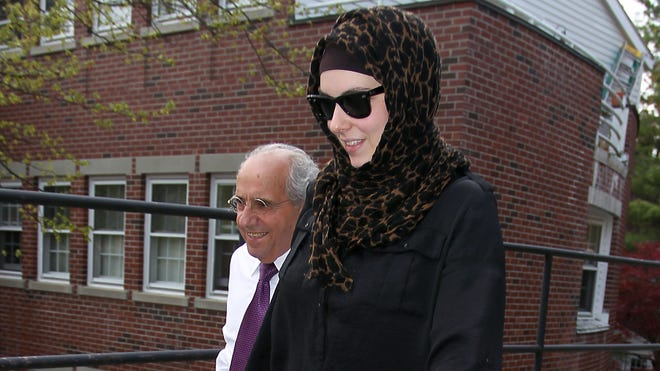 Katherine Russell, wife of Boston Marathon bomber suspect Tamerlan Tsarnaev, leaves the law office of DeLuca and Weizenbaum with Amato DeLuca on April 29 in Providence, R.I.