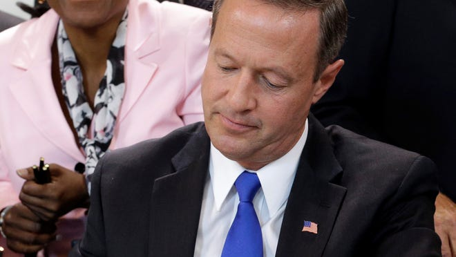 Maryland Gov. Martin O'Malley signs a bill abolishing capital punishment in the state Thursday.