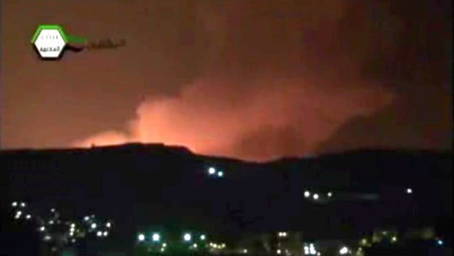 Smoke and fire fill the the skyline over Damascus, Syria, early Sunday after an Israeli airstrike.