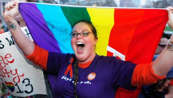 Rachel Ford cheers during a rally supporting a same-sex marriage bill in Minnesota on the steps of the State Capitol on May 8.