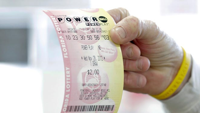 Customer buys Powerball ticket in Tampa in November.