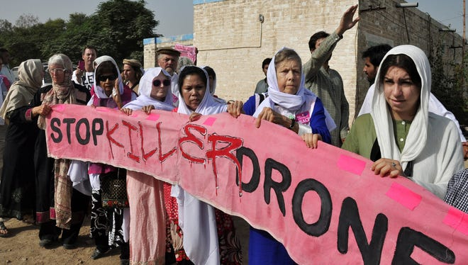 American citizens hold a banner during a peace march Oct. 7, 2012. It was organized by Pakistan's cricket star turned politician Imran Khan's party, not pictured, in Tank, Pakistan.