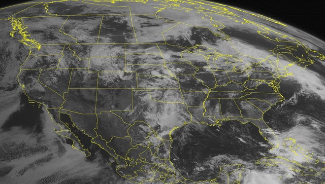 This NOAA satellite image taken Wednesday, May 29, 2013 at 10:45 AM ET shows a low-pressure system over the central United States with widespread showers and thunderstorms from Texas into the Northern Plains. Farther east, a warm front extended into the Northeast with showers and thunderstorms.