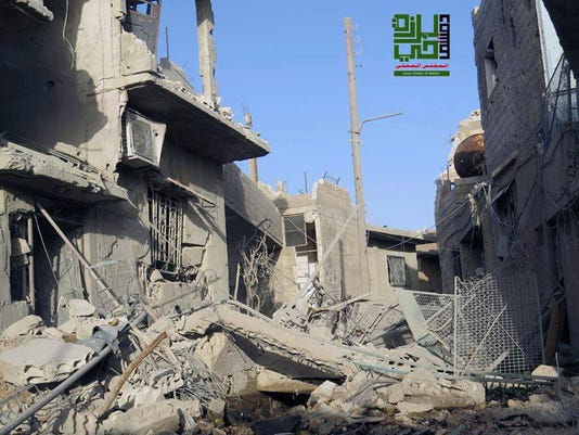 Destroyed homes from government airstrikes and shelling, in the Barzeh district of Damascus, Syria.
