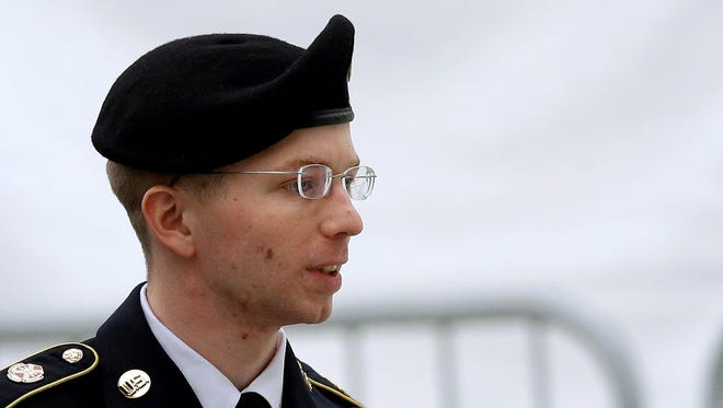 Bradley Manning is escorted into a courthouse in Fort Meade, Md., before a pretrial military hearing.
