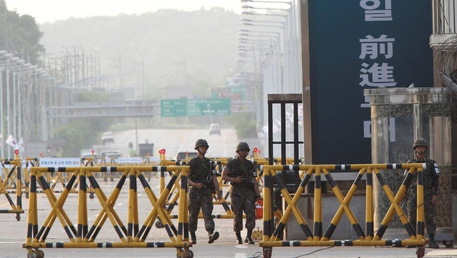 South Korean Army soldiers patrol on Unification bridge, which leads to the demilitarized zone, separating North Korea from South Korea.