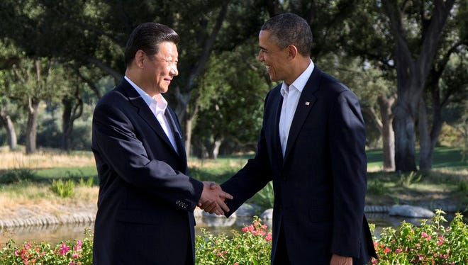 President Barack Obama shakes hands with Chinese President Xi Jinping at the Annenberg Retreat at Sunnylands as they meet for talks Friday.