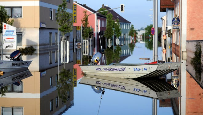 Buildings and boats are reflected in the floodwater of the river Danube in Deggendorf, southern Germany, June 7, 2013.
