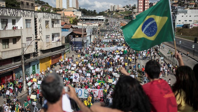 People march during a protest in Belo Horizonte, Brazil, continuing a wave of protests that have shaken the nation and pushed the government to promise a crackdown on corruption and greater spending on social services.