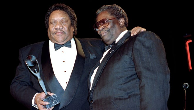 """In this Jan. 15, 1992, file photo, Bobby """"Blue"""" Bland, left, receives his award for the Rock and Roll Hall of Fame from B.B. King during induction ceremonies in New York."""