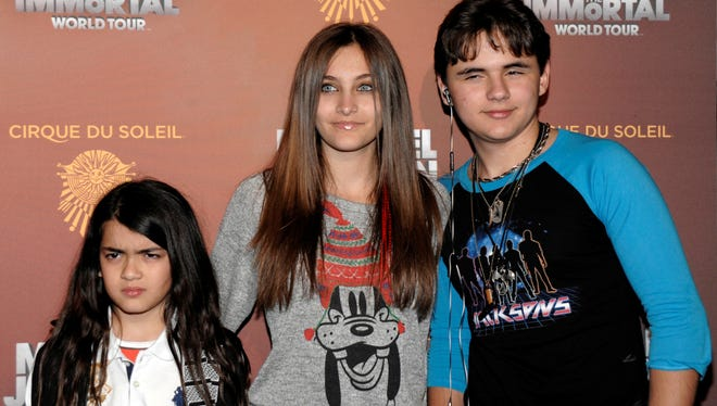 Blanket Jackson, Paris Jackson and Prince Michael Jackson attend opening night of the Michael Jackson The Immortal World Tour in Los Angeles in 2012.