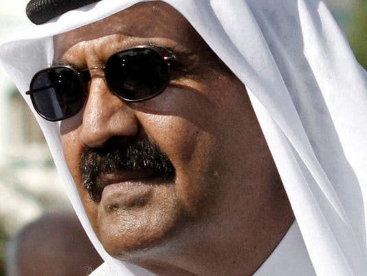 Qatar ruler hands over power to son