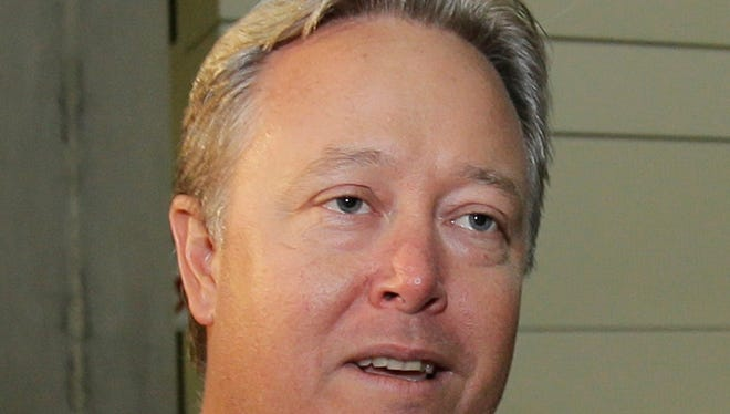 Chip Starnes talks to reporters at his arrival at Fort Lauderdale-Hollywood Airport early on June 28, 2013.