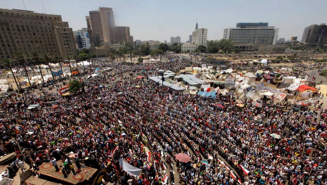 Opponents of Egypt's Islamist President Mohammed Morsi gather for noon prayers in Tahrir Square, the focal point of the Egyptian uprising, in Cairo on Sunday.
