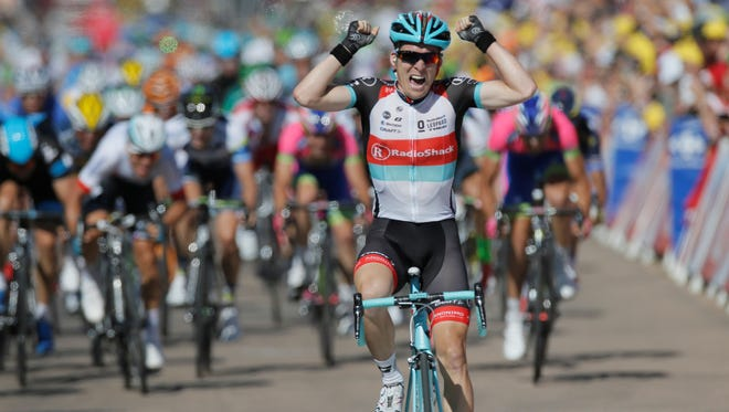 Jan Bakelants of Belgium crosses the finish line to win the second stage of the Tour de France.