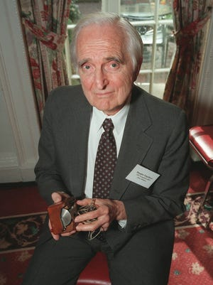 An April 9, 1997, photo of Doug Engelbart, inventor of the computer mouse and winner of the half-million dollar 1997 Lemelson-MIT prize, poses with the computer mouse he designed, in New York.