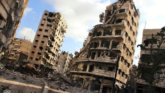 Buildings damaged by Syrian government airstrikes and shelling, in the Jouret al-Chiyah neighborhood of Homs, Syria.
