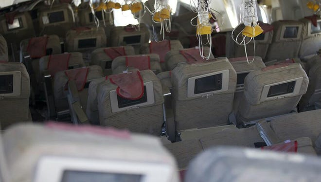 This image released Sunday shows the interior of the Boeing 777 Asiana Airlines Flight 214.
