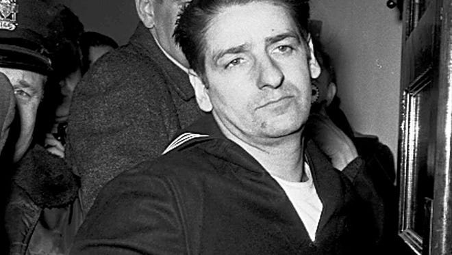 This Feb. 25, 1967, file photo shows Albert DeSalvo minutes after his capture in Boston.