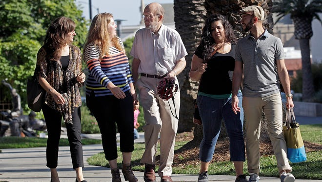 Straight and gay members of OneTable, from left,  Samantha Curley, Chelsea McInturff, faculty adviser Glen Stassen, Marissa Nunes and Nick Palacios walk on the campus of the Fuller Theological Seminary in Pasadena, Calif.  Fuller, the largest multi-denominational seminary in the world, became the first such school to sanction an official student organization - OneTable -  for gay, lesbian, bisexual and transgendered students earlier this year.