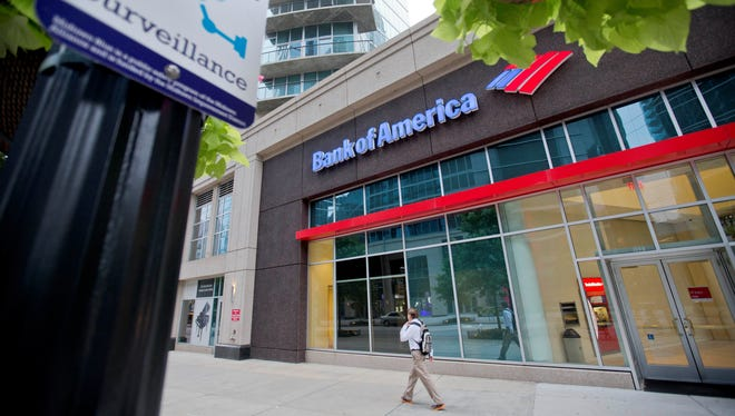 """A surveillance sign is posted outside a Bank of America branch on Peachtree Street, on June 16 in Atlanta. Banks large and small are girding for an elaborate drill this week that will test how they'd fare if hackers unleashed a powerful and coordinated attack against them. The exercise is being called """"Quantum Dawn 2,"""" and if the name sounds like a video game, it's also meant to convey the seriousness of a big threat."""