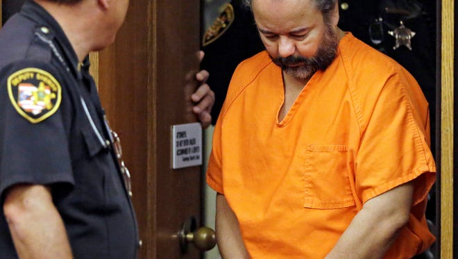 Ariel Castro is led into court for a pretrial hearing.