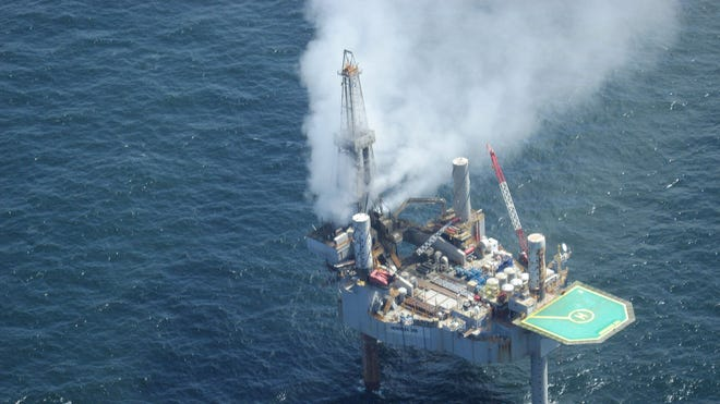 This photo released by the Bureau of Safety and Environmental Enforcement shows natural gas spewing from the Hercules 265 drilling rig in the Gulf of Mexico off the coast of Louisiana.