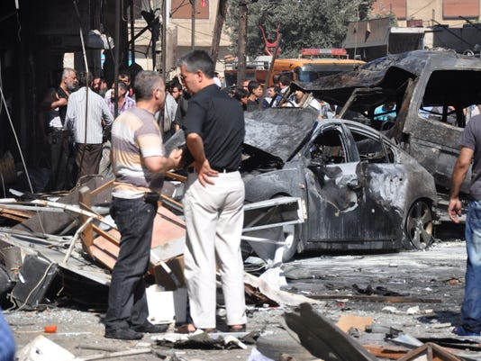 Damage after car bomb explodes in Syria
