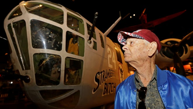 Dale Hulsey, from Forth Worth Texas, views a B24 bomber like the one he flew in the Ploesti Raid during World War II while touring the United States Air Force Museum, Wednesday.
