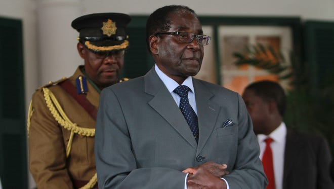Zimbabwean President Robert Mugabe  addresses a press conference at State House in Harare on July 30.