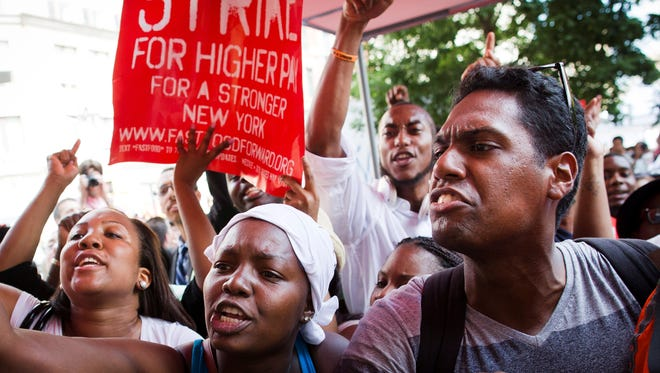 Demonstrators supporting fast food workers protest outside a McDonald's restaurant in New York's Union Square to demand higher wages and the right to form a union without retaliation on July 19.