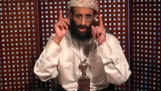 In this Nov. 8, 2010 image taken from video and released by SITE Intelligence Group on Monday, Anwar al-Awlaki speaks in a video message posted on radical websites.
