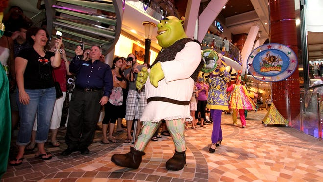 """Characters from """"Shrek"""" march in a parade aboard Royal Caribbean's Allure of the Seas."""