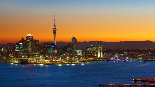 The skyline of Auckland, New Zealand at dusk.