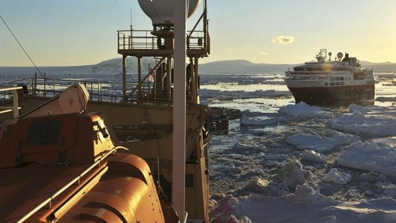 The British navy's HMS Protector, an ice breaker, sailing near the Hurtigruten line's 276-passenger Fram.