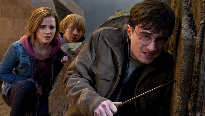 """Emma Watson, Rupert Grint and Daniel Radcliffe in a scene from """"Harry Potter and the Deathly Hallows: Part 2."""""""