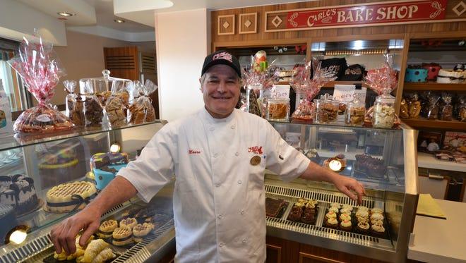 Mauro Belgiovine of Carlo's Bake Shop at the bakery's new outlet on Norwegian Cruise Line's Norwegian Breakaway.