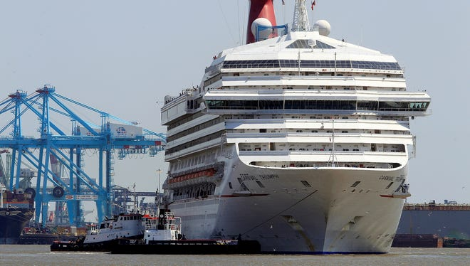 The Carnival Triumph departs from the Alabama Cruise Terminal in Mobile, Ala., on May 8, 2013. The ship was docked for repairs in Mobile for about three months because of an engine room fire that disabled the vessel.