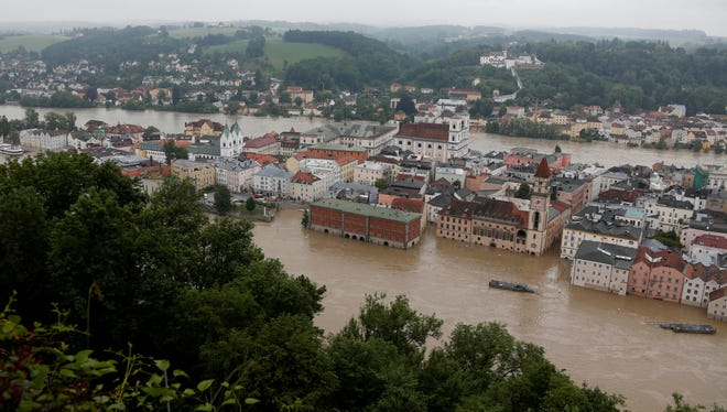 Raging waters from three rivers have flooded large parts of Passau, Germany, following days of heavy rainfall in central Europe.