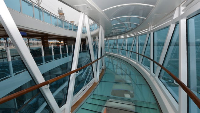 The glass-enclosed SeaWalk on Princess Cruises' Royal Princess is cantilevered over the side of the ship.