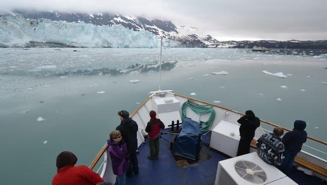 Cruise ship passengers view Marjorie Glacier in Alaska's Glacier Bay National Park.