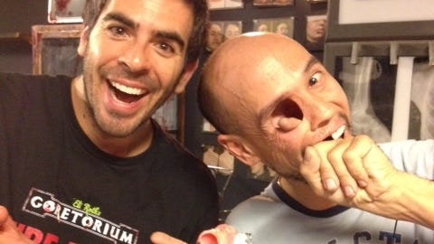 Horror film producer/director/actor Eli Roth poses with a one-eyed cast member at the new GORETORIUM in Vegas.