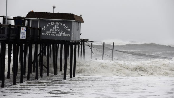 Part of the Ocean City Fishing Pier is missing, and the fence dangles in the water,  as Hurricane Sandy bore down on the East Coast Monday.
