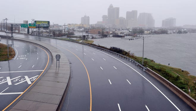 An empty road lead to casinos before the arrival of Hurricane Sandy October 29, in Atlantic City, N.J.
