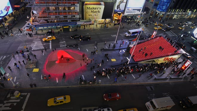 The 'Heartwalk' sculpture is a public art installation made from boardwalk pieces damaged in Hurricane Sandy. This artist rendering shows the heart-shaped structure. Also erected in Times Square: Red steps where couples will renew vows on Valentine's Day.