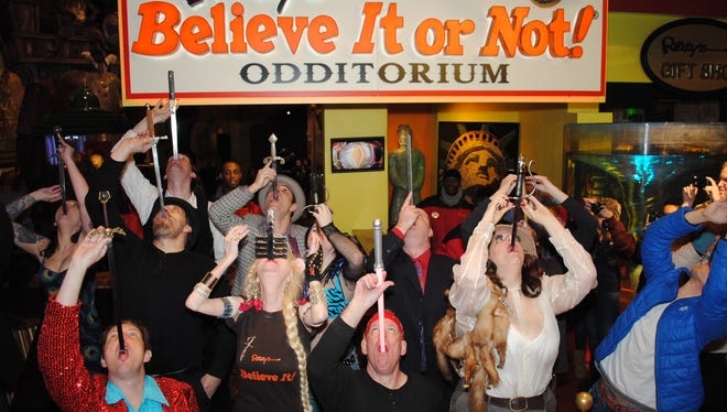 Sword swallowers do their thing at Ripley's Believe It or Not! Times Square at 2012's World Sword Swallower's Day.